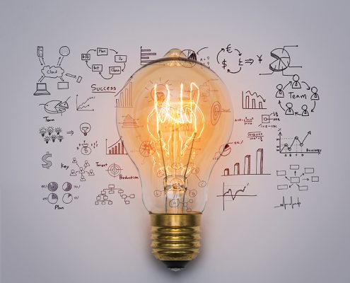 Lightbulb on a background of hand drawn illustrations representing innovation